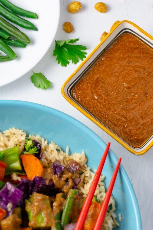 thai peanut stir-fry sauce with veggies and rice