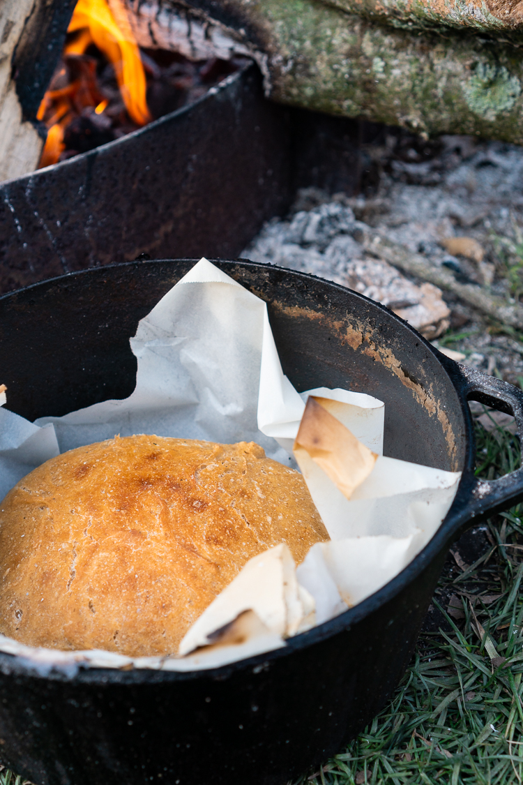 easy homemade dutch oven bread loaf recipe baked over campfire